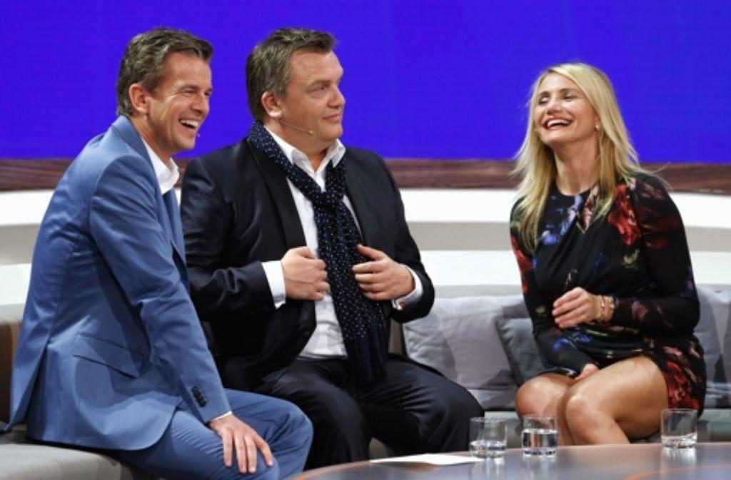 Cameron Diaz kann nichts Schlechtes über Markus Lanz (links, mit Hape Kerkeling) und Wetten, dass ..? berichten. Foto: Getty Images Europe