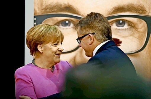 Von Paris reiste Angela Merkel zum CDU-Parteitag nach Ettlingen, um Guido Wolf   aufzumuntern. Foto: dpa