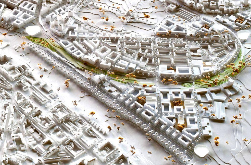 Der Entwurf des Büros ASP und weiterer Planungsbüros, der den ersten Preis erhielt: Ein Gleisbogenpark verläuft zwischen dem Nordbahnhofviertel (oben) und dem neuen Rosensteinquartier (unten) Foto: ASP Architekten/Koeber Landschaftsarchitektur