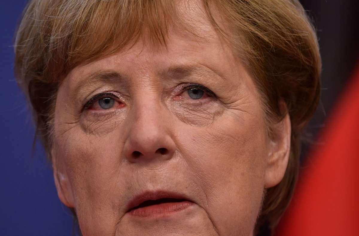 Kanzlerin Merkels Kommentierung der Wahl in Thüringen nimmt die AfD zum Anlass, ihr Amtsmissbrauch vorzuwerfen. Foto: dpa/John Thys