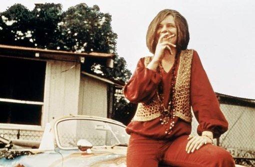 So lustig und mit buntem Porsche hat man Janis Joplin in Erinnerung. Aber das Love-and-Peace-Lachen war Fassade. Foto: Arsenal