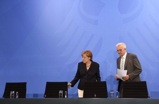Kanzlerin Angela Merkel und der baden-württembergische Ministerpräsident Winfried Kretschmann im Anschluss an ein Treffen der Ministerpräsidentenkonferenz in Berlin (Archivfoto) Foto: dpa