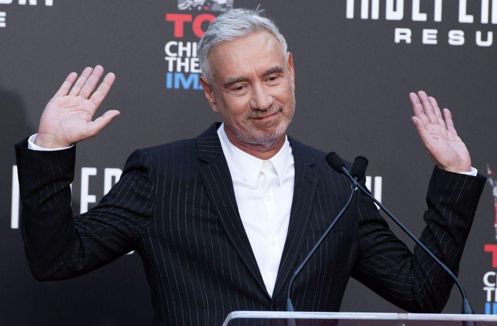 Auch wenn er da fast abwehrend die Hände hebt: Den Carl-Laemmle-Produzentenpreis wird Roland Emmerich gewiss nicht ablehnen. Foto: AFP