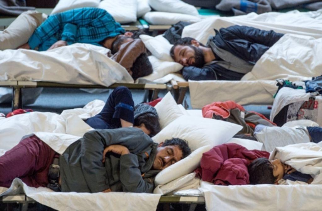 Flüchtlinge in einer Massenunterkunft. Für ihre Flucht gibt nicht nur eine Ursache. Foto: dpa