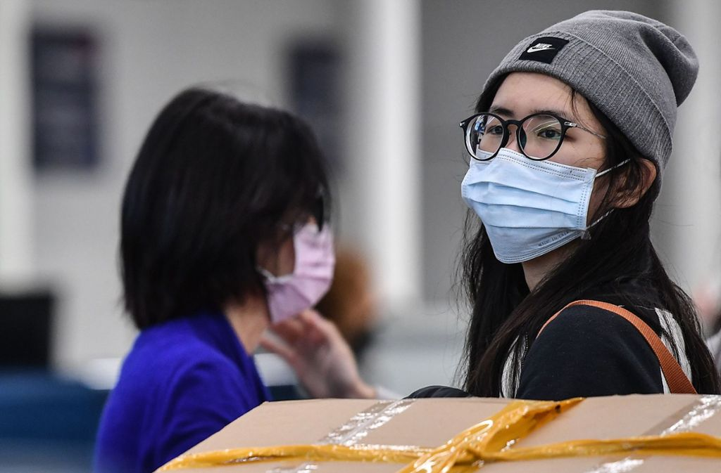 Können Pakete aus China Coronaviren übertragen? (Symbolbild) Foto: AFP/TIZIANA FABI