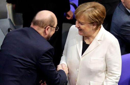 Knappe Mehrheit für Angela Merkel