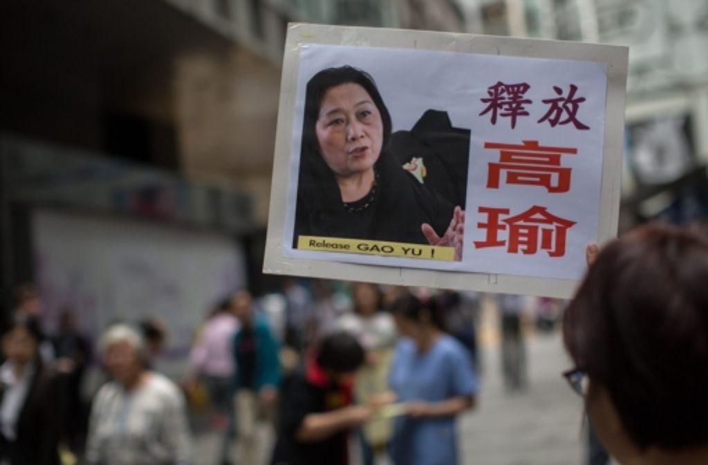Chinesische Aktivisten machen sich stark für die China-Kritikerin Gao Yu. Foto: dpa