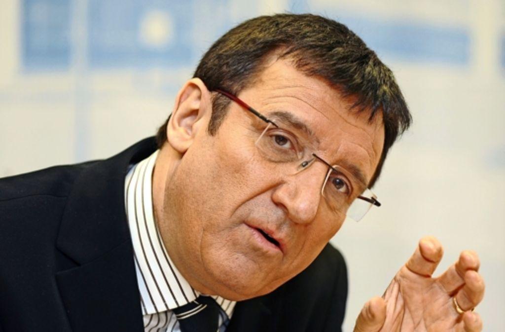Diener zweier Herren? Wolfgang Reinhart (CDU) sieht das anders. Foto: dpa