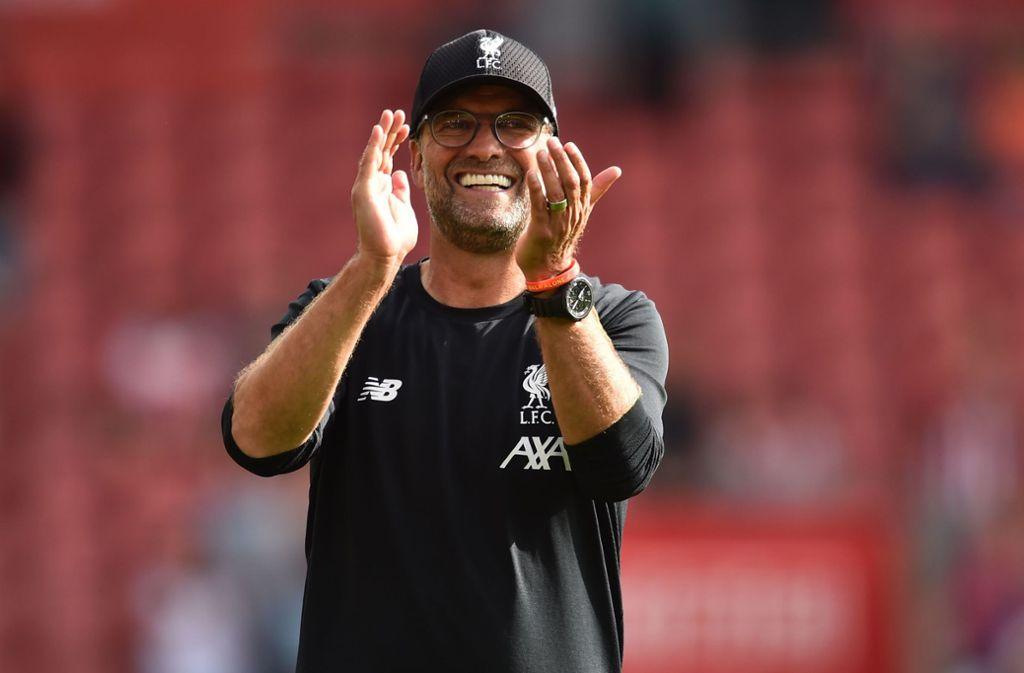 Glücklich in Liverpool: Jürgen Klopp hat seinen Vertrag verlängert. Foto: AFP/GLYN KIRK