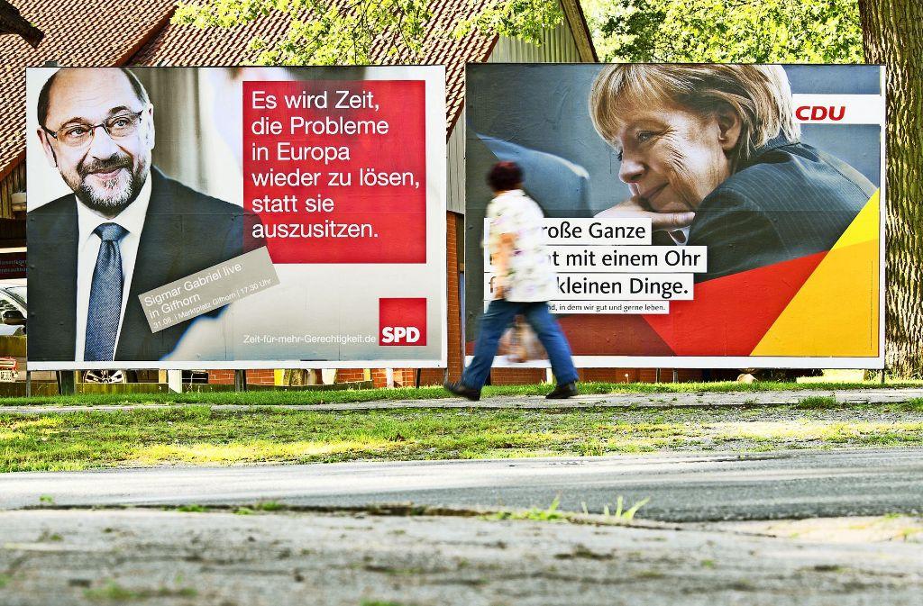 SPD und CDU werben mit Großplakaten für ihre Parteichefs und Spitzenkandidaten Martin Schulz und Angela Merkel. Foto: dpa