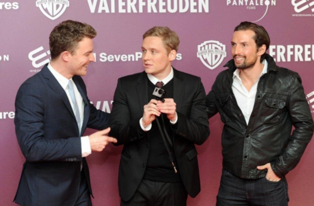Matthias Schweighöfer (Mitte), Friedrich Mücke (links) und der Produzent Quirin Berg bei der Premiere von Vaterfreuden in München. Foto: dpa