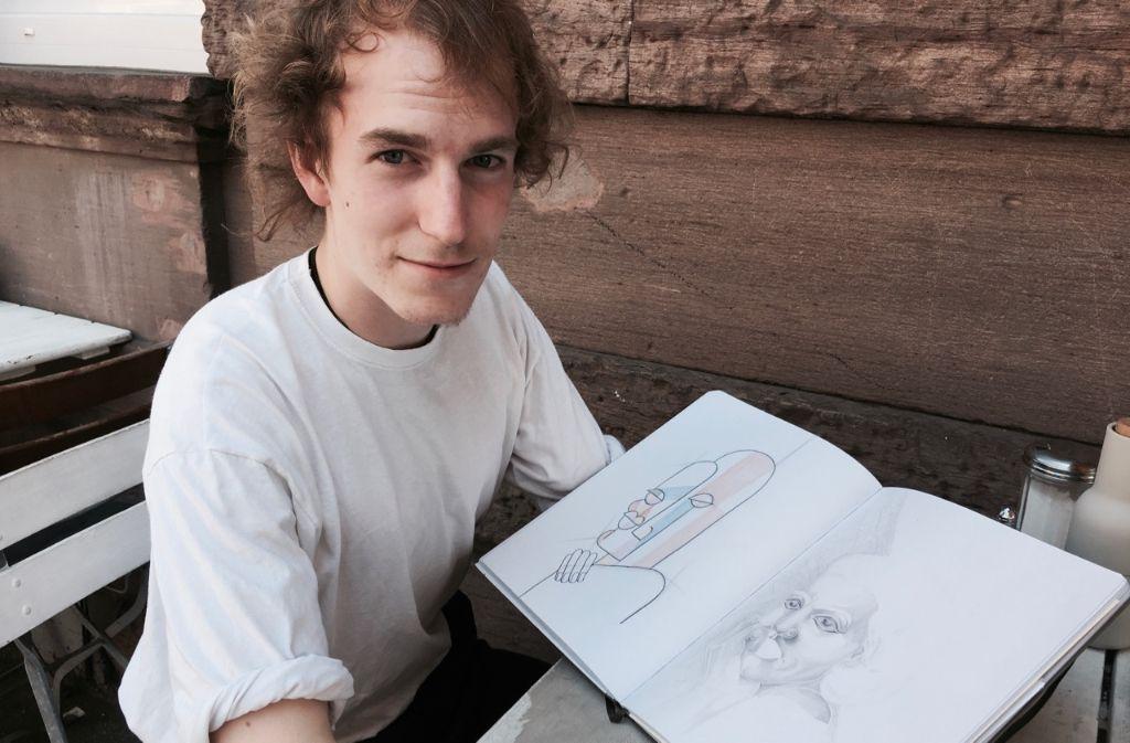 Der Künstler Jan-Georg Hendricks mit seinem Skizzenbuch. Foto: Tanja Simoncev