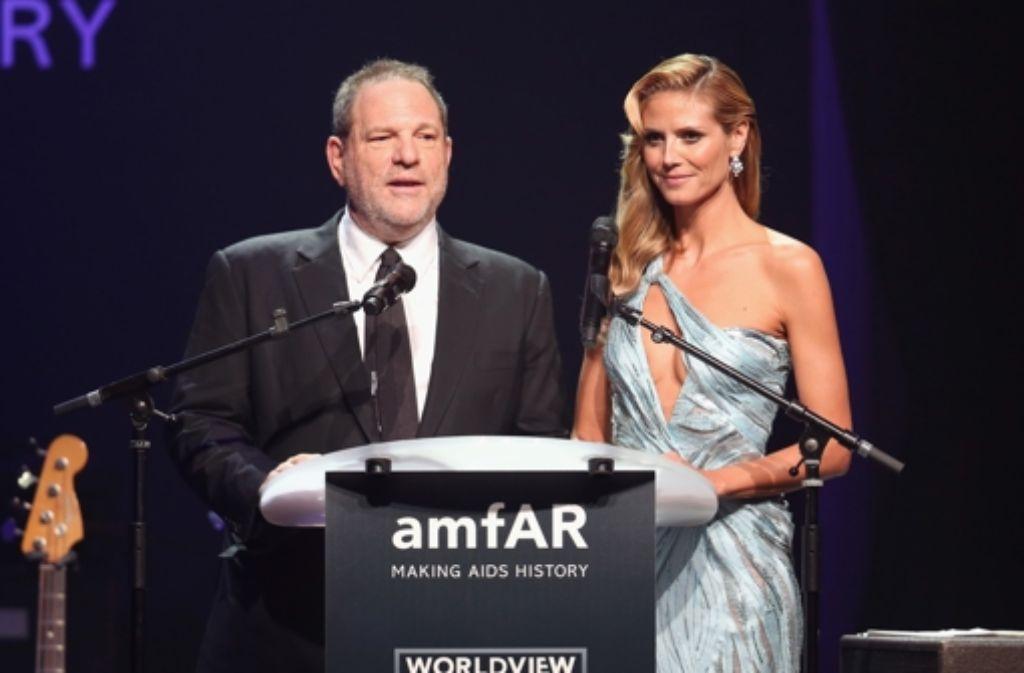 Zusammen mit Filmmogul Harvey Weinstein versteigerte Heidi Klum auf der Amfar-Gala in Cannes moderne Kunst. Foto: Getty Images Europe