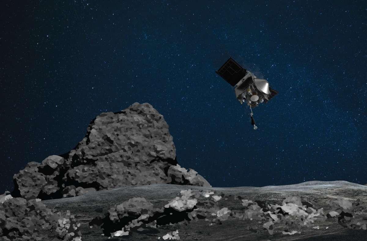 """Die Raumsonde """"Osiris Rex""""  nähert sich dem Asteroiden Bennu (künstlerische Darstellung). In der Nacht zum 21. Oktober hatte sich die Nasa-Sonde erfolgreich dem Asteroiden bis auf wenige Meter genähert und Bodenproben zu sammeln. Foto: Nasa/Goddard/University of Arizona/AP/dpa"""