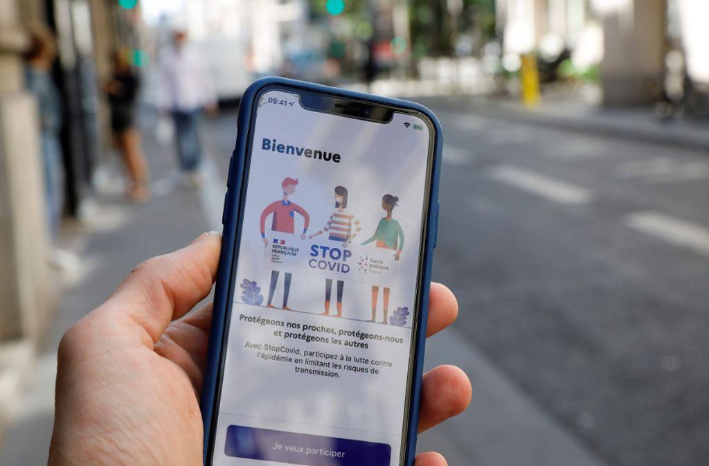 """So sieht die französische Corona-Warn-App """"StopCovid"""" aus. Foto: AFP/THOMAS SAMSON"""