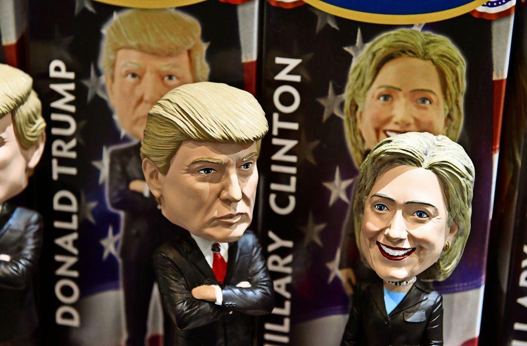 Der Wettkampf zwischen Donald Trump und Hillary Clinton um das Präsidentenamt  gilt als einer der heftigsten in der Geschichte der USA. Foto: AFP