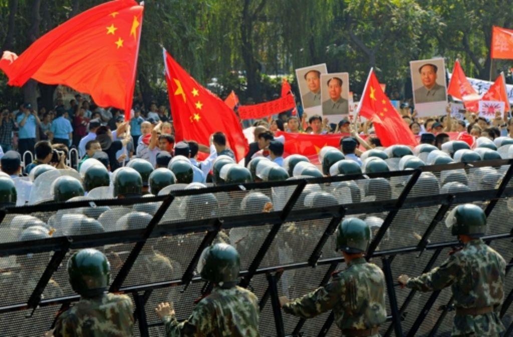 Maos Kampf gegen Japan ist bei den Demonstranten unvergessen. Foto: AFP