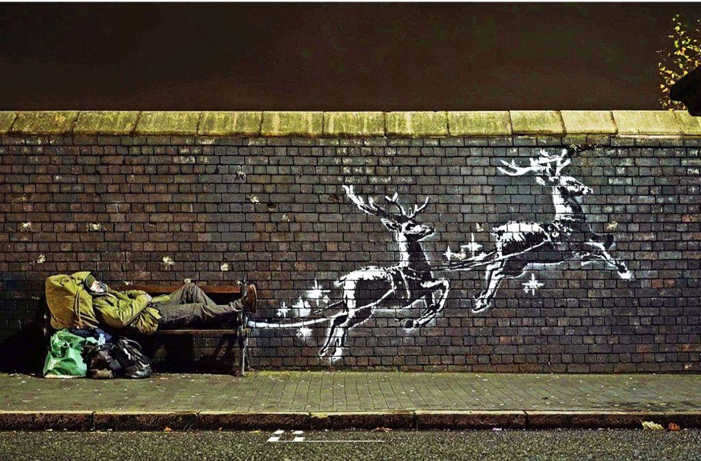 Botschaft zum Weihnachtsfest: das neue Banksy-Werk, auf einer Mauer in Birmingham Foto: dpa/Banksy