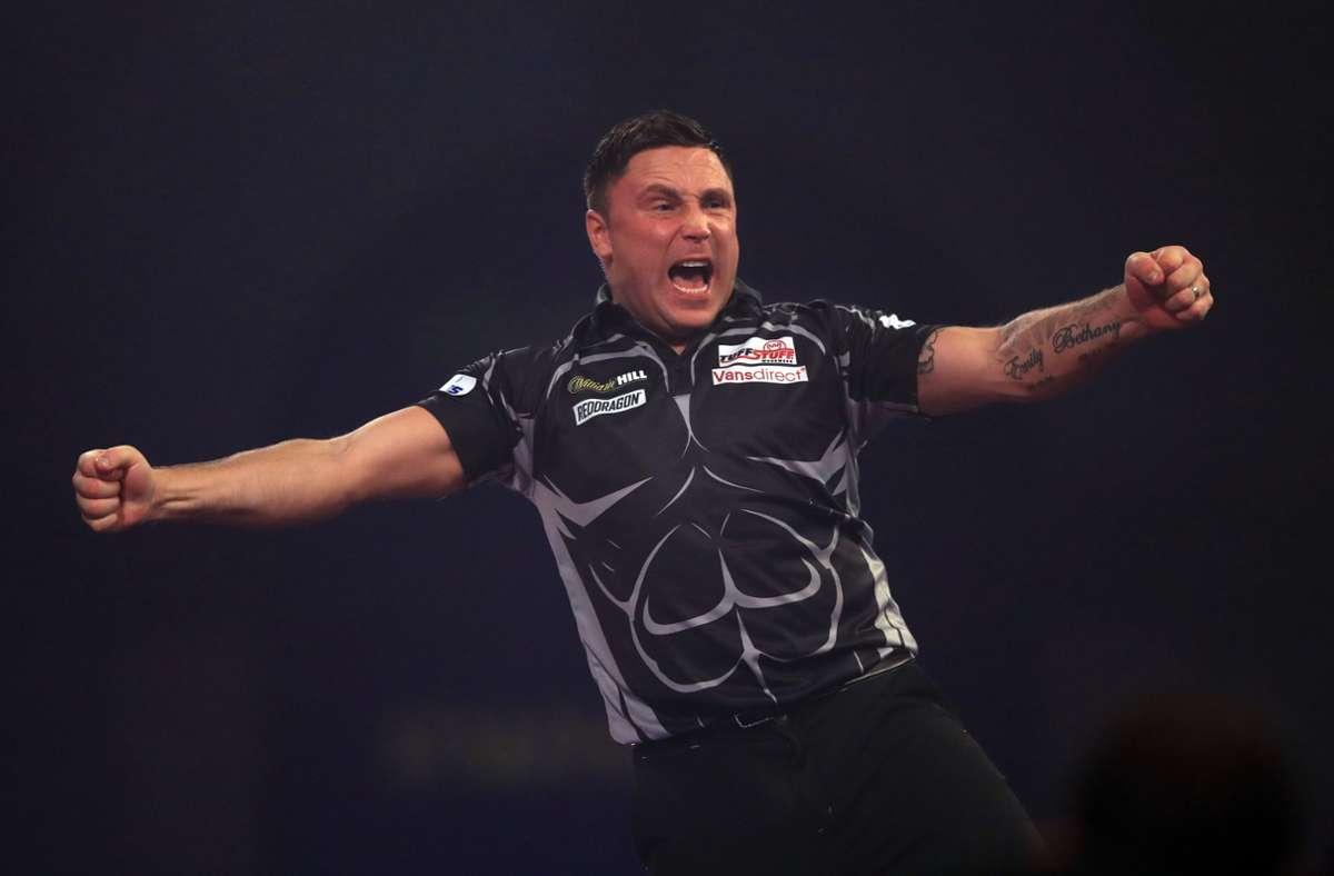 Freudenschrei des Weltmeisters: Gerwyn Price  feiert seinen Triumph in London Foto: dpa/Adam Davy