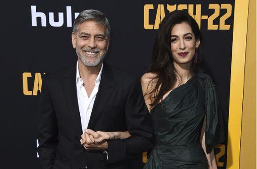 Die Clooneys strahlen auf dem roten Teppich