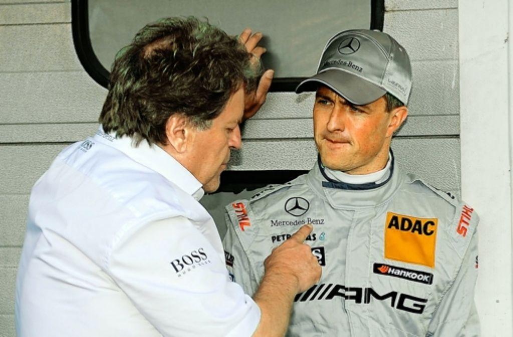 Du, drück' doch mal ein bisschen mehr aufs Gas: Mercedes-Motorsportchef Norbert Haug (links) im Gespräch mit Ralf Schumacher. Foto: dapd