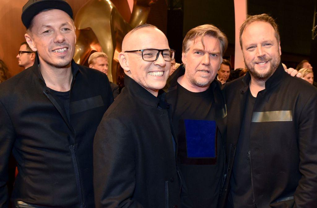 Vier gut gelaunte Herren: Die Fantastischen Vier (von links: Michi Beck, Thomas D., And.Y und Smudo) haben ein neues Album und zwei Stuttgart-Konzerte in petto. Foto: dpa