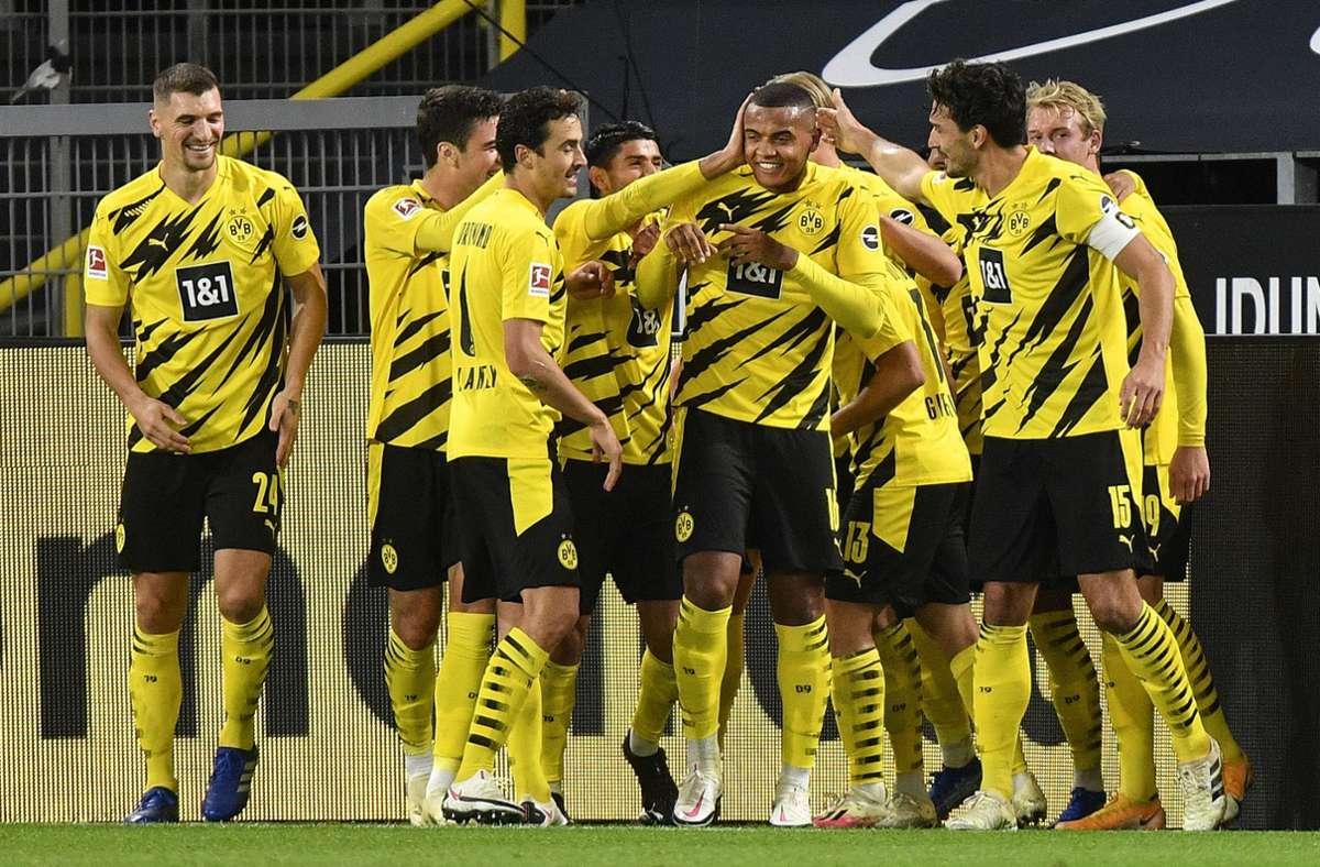 Gleich dreimal hatten die Dortmunder Spieler Grund zum Jubel. Foto: dpa/Martin Meissner