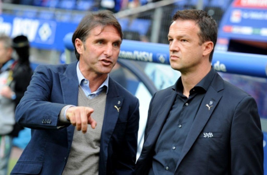 Bruno Labbadia (links) und der VfB Stuttgart (verkörpert durch Fredi Bobic) – das ist eher eine Zweckgemeinschaft als eine Lustfrage. Foto: dpa