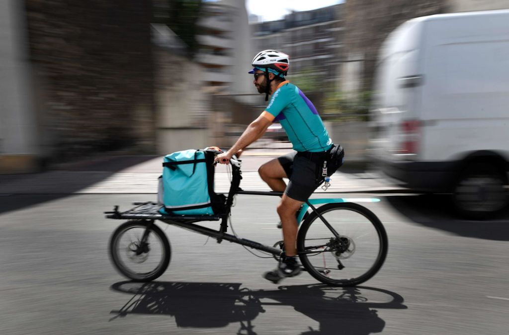 Deliveroo will seine Fahrer und Angestellten abfinden. Foto: AFP