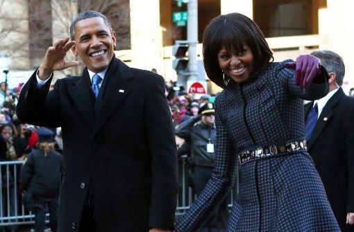 Triumphzug durch Washingtons Straßen: US-Präsident Barack Obama (mit seiner Frau Michelle) hat am Montag bei einer feierlichen Zeremonie erneut seinen Amtseid abgelegt.  Foto: dpa