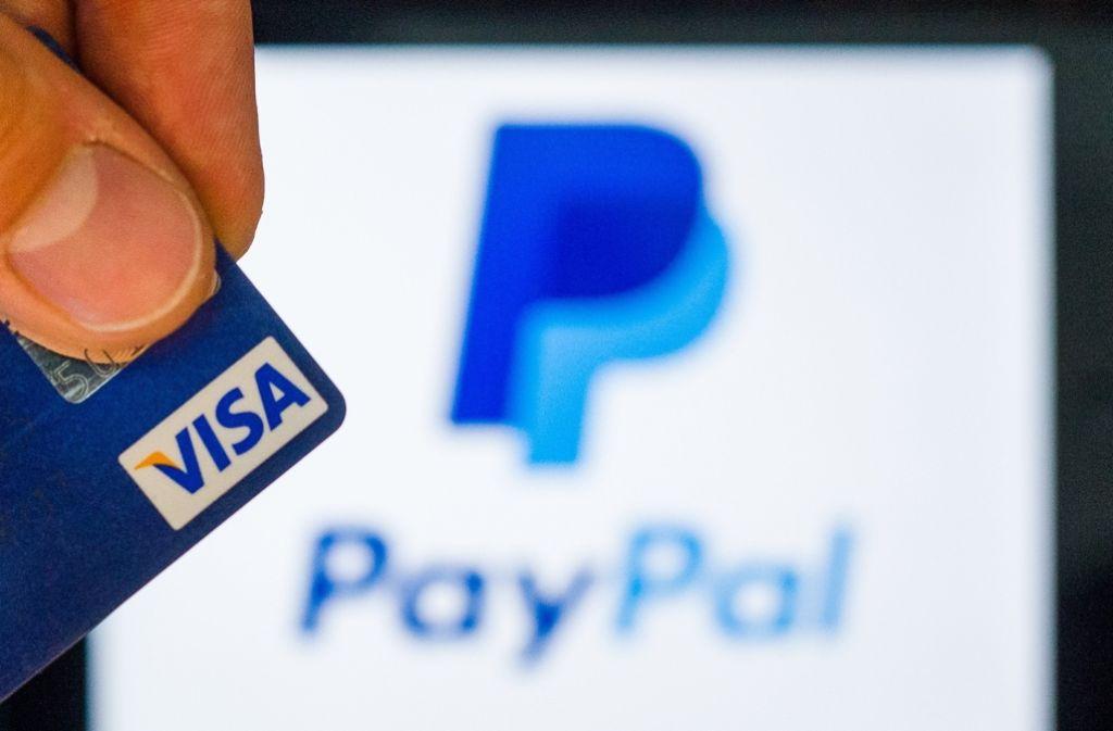 Die Partnerschaft mit Visa eröffnet Paypal den Weg an die Ladenkassen. Foto: dpa