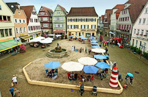 Der Marktplatz wird zum Sandkasten