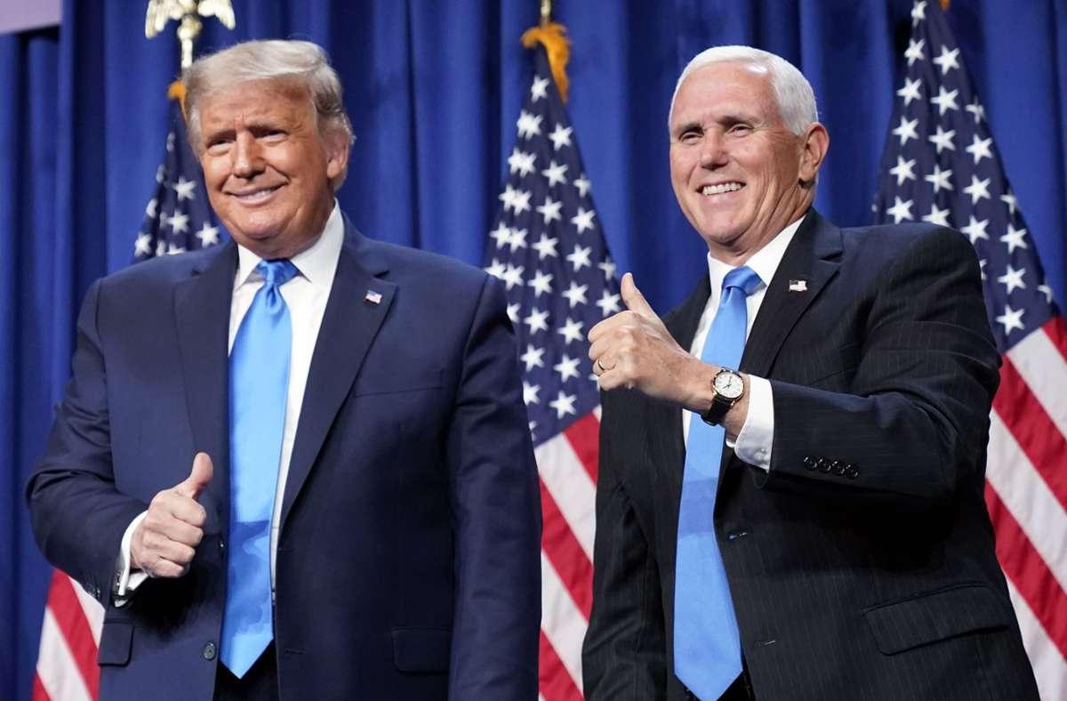 Daumen hoch?  Mike Pence will in einem Buch auch über Donald Trump schreiben. Foto: dpa/Andrew Harnik