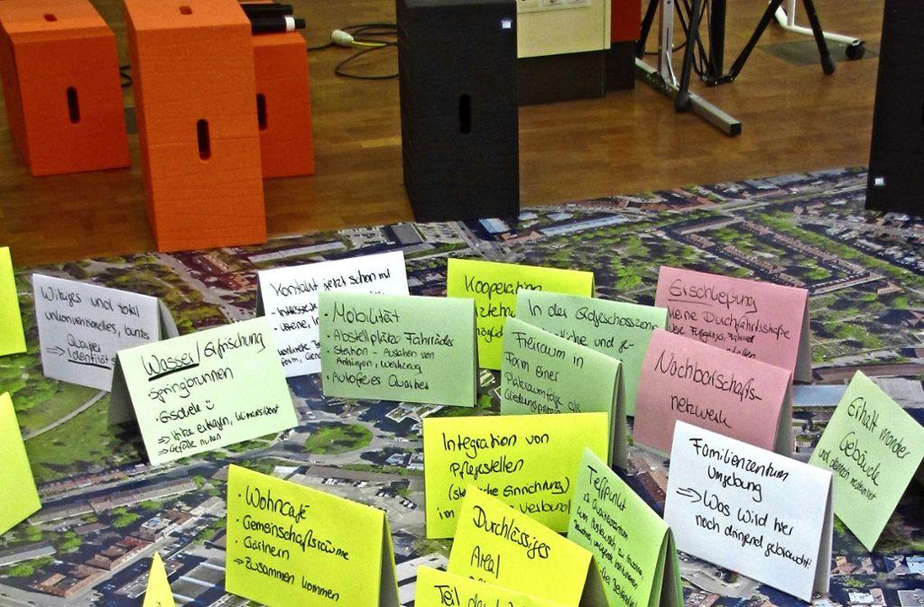 Die Anwohner haben bei der Bürger-Werkstatt auf Zettel geschrieben, wie sich sie das neue Wohnquartier im Stöckach wünschen. Foto: