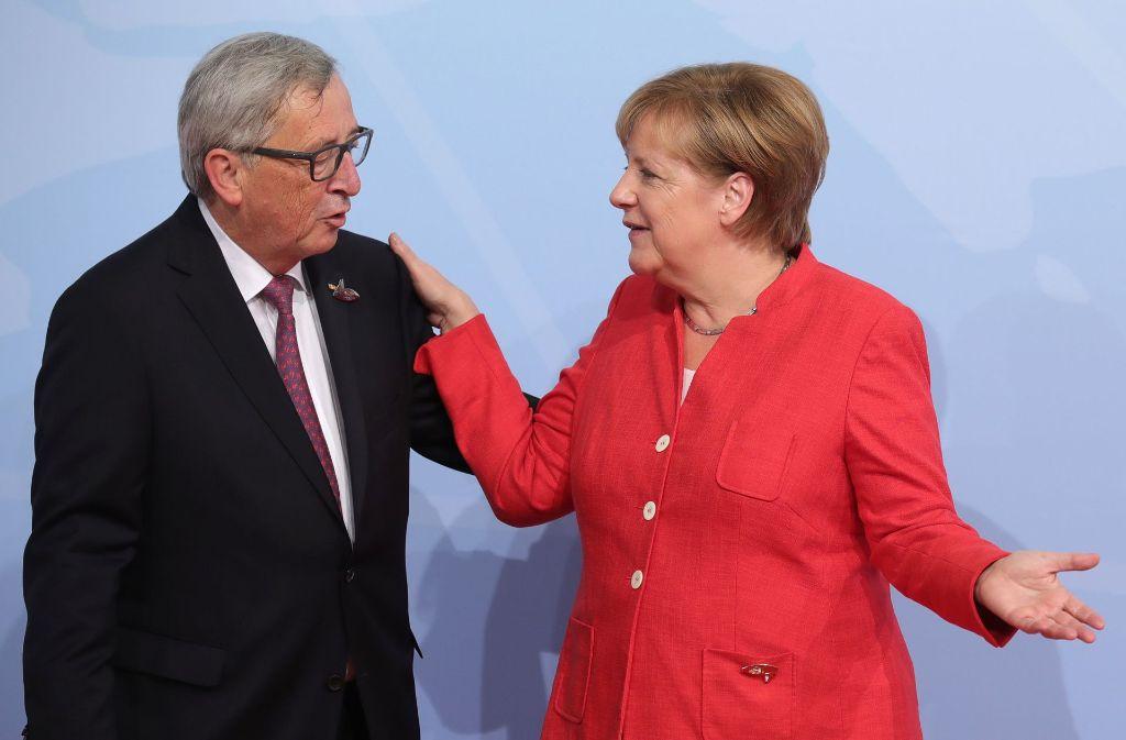 Zwei, die sich gut verstehen: Jean-Claude Juncker und Angela Merkel. Foto: dpa
