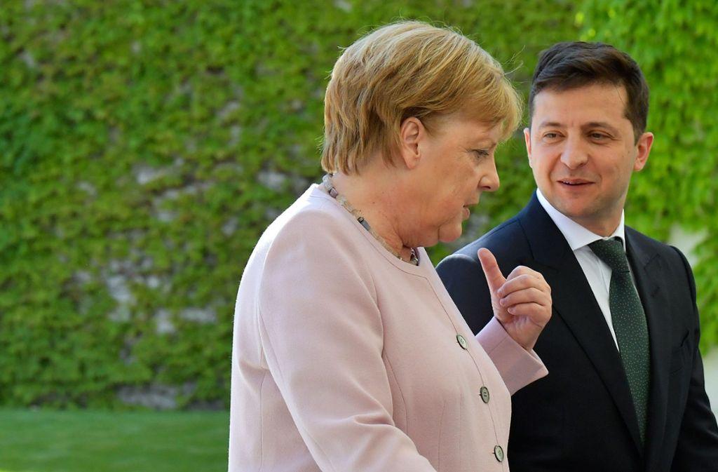 Beim Besuch des neuen ukrainischen Präsidenten hatte Angela Merkel einen Zitteranfall. Foto: AFP