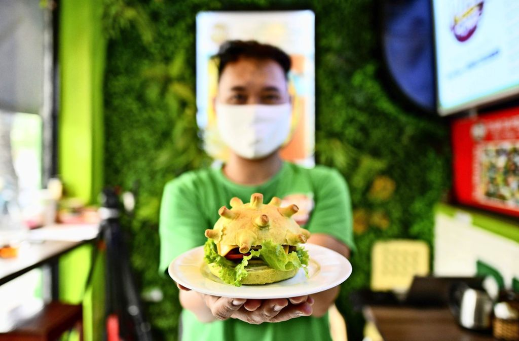 Es muss ja nicht gleich ein Corona-Burger sein. Foto: afp/Manan Vatsyayana