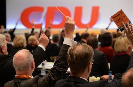 Angela Merkel ist die CDU – und die CDU ist Angela Merkel. Foto: dapd
