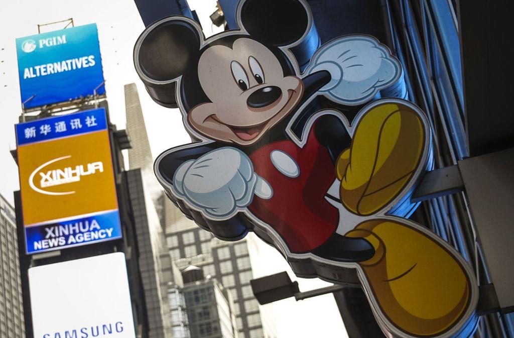 Micky hat – wie hier vorm Disney-Laden am Times Square – gut grinsen: Walt Disney wird immer mächtiger. Foto: AFP/Getty