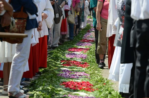 Prozessionen und Blumenteppiche