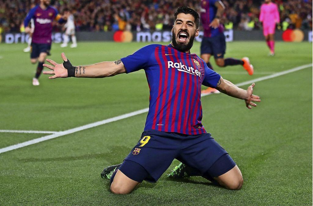 Luis Suárez beim Torjubel: Der Stürmerstar steht seit seiner Beißattacke unter verstärkter medialer Beobachtung – und besticht neuerdings durch ganz besondere Regelkenntnisse. Foto: