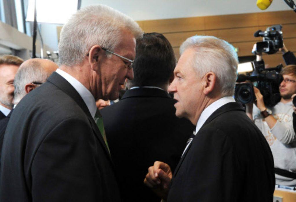Ministerpräsident Kretschmann (Grüne, links) und Bahnchef Grube treffen sich am Montag. Foto: dpa