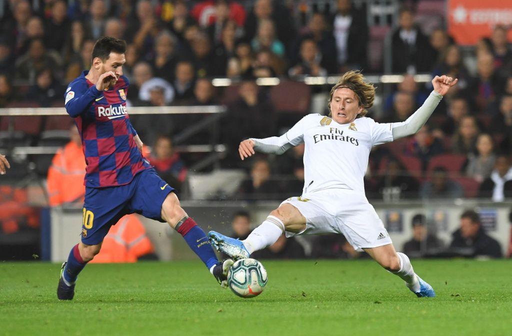Wann stehen die Weltfußballer Lionel Messi und Luka Modric wieder auf dem Platz? Foto: imago images/Paco Largo