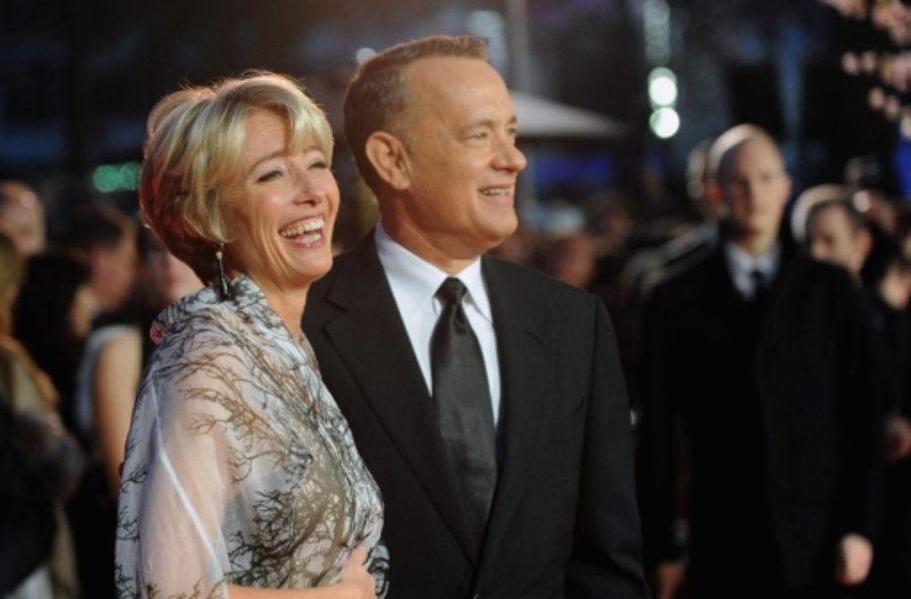 Den Regen einfach weglächeln: Tom Hanks und Emma Thompson bei der Weltpremiere von Saving Mr. Banks in London. Foto: Getty Images Europe