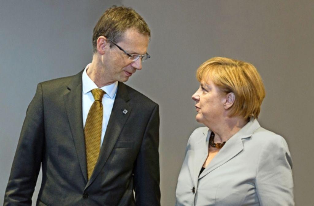 Ein eher seltenes Bild, denn Uwe Corsepius lässt sich nicht gerne zusammen mit seiner Chefin ablichten Foto: Polaris/laif