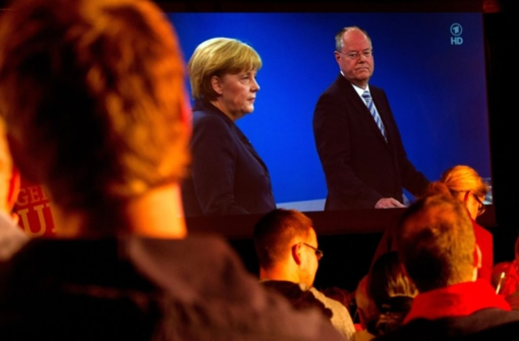 Angela Merkel und Peer Steinbrück im TV-Duell – und Deutschland schaut zu. Foto: dpa