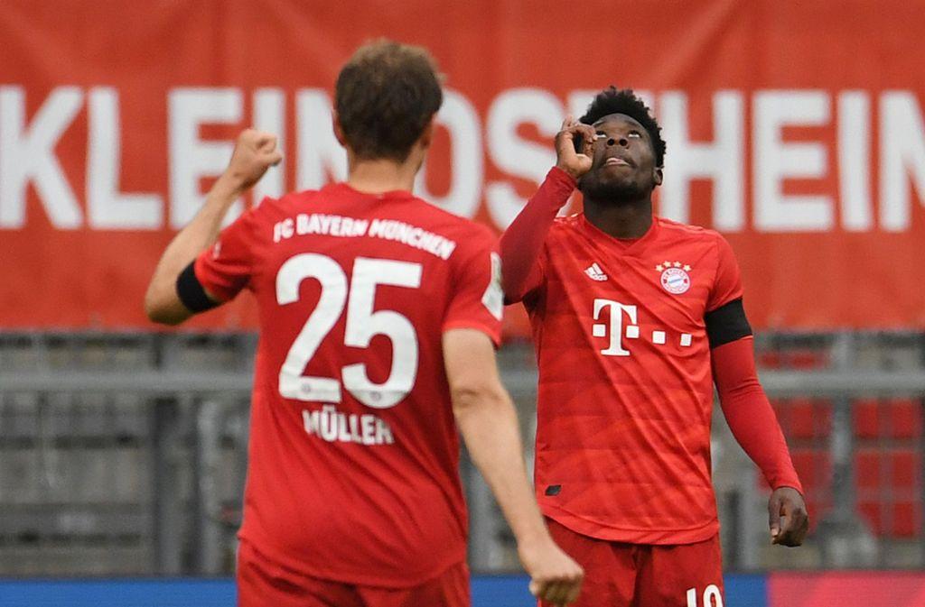Torschützen unter sich: Thomas Müller und Alphonso Davies trafen gegen Eintracht Frankfurt. Foto: dpa/Andreas Gebert
