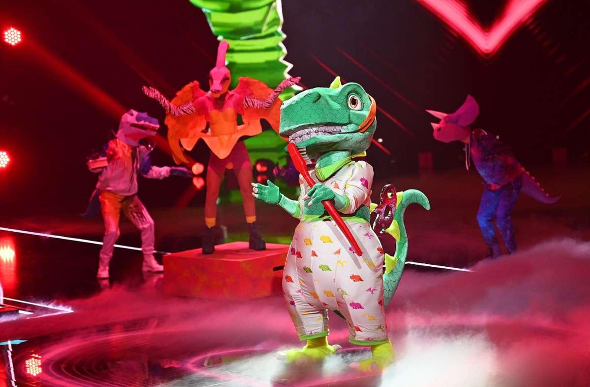 """Der Dinosaurier gewinnt die vierte Staffel von """"The Masked Singer"""". Foto: dpa/Willi Weber"""
