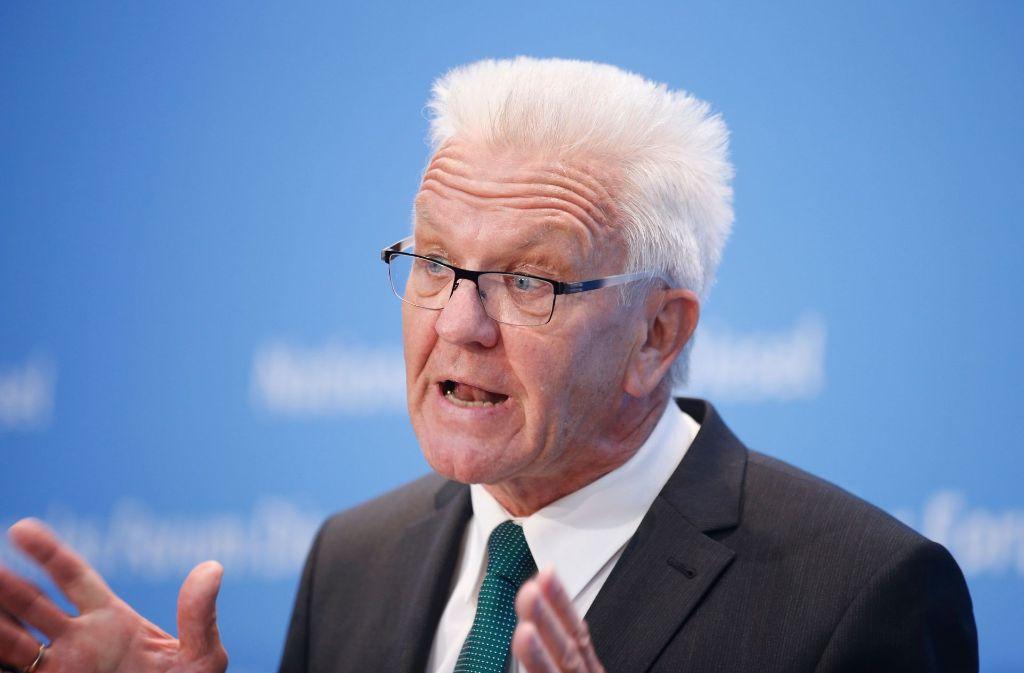 Winfried Kretschmann ist zufrieden mit dem Diesel-Gipfel – seine Parteifreunde sind es weniger. Foto: AFP