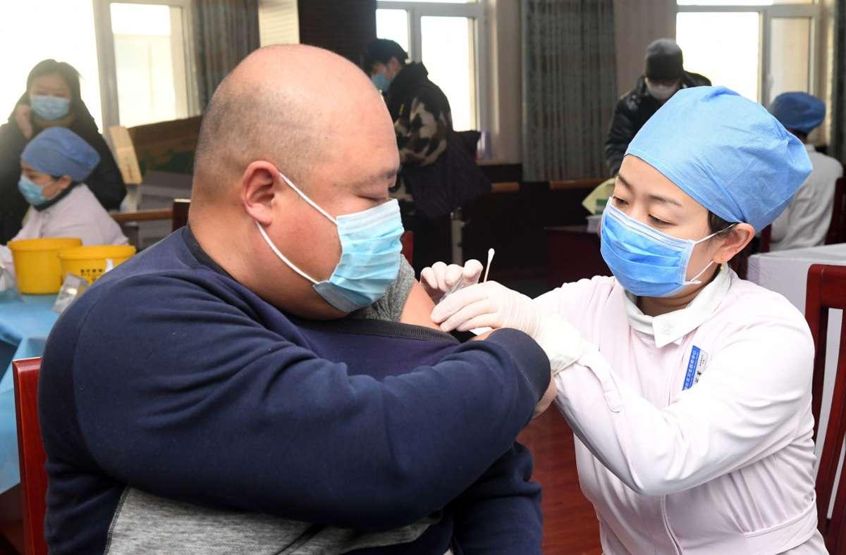 Vor dem Neujahrsfest lassen sich Chinesen besonders gerne impfen. Foto: dpa/Ren Chao